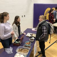 CCVI students manage the bake sale table. No shortage of things to make the day sweet! image