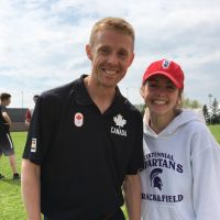 Canadian Olympian Eric Gillis chats with Amber, an Olympic hopeful, at CCVI in Guelph. image