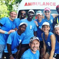 2018 Team Canada and St Lucia glad to be outside of the ambulance - not in! Missing from photo is CDN runner and trainer Albert Klein. image