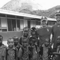 Soufriere Primary School students with Richard Clewes and Jake Holden in January, 2016. (Sochi Winter Olympics 2014, Snowcross) image